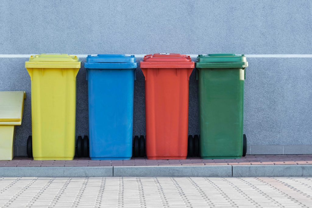Four colorful garbage bins