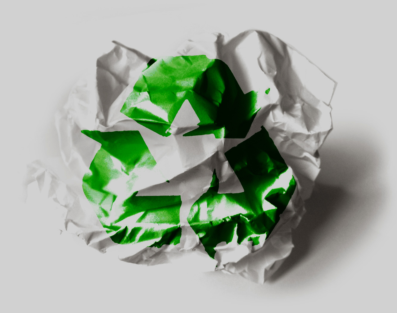 crumpled paper with recycling logo