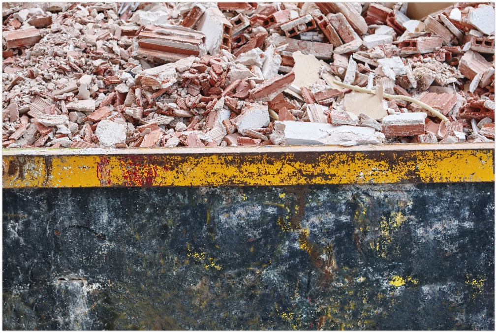 Removal of debris. Construction waste. Building demolition.