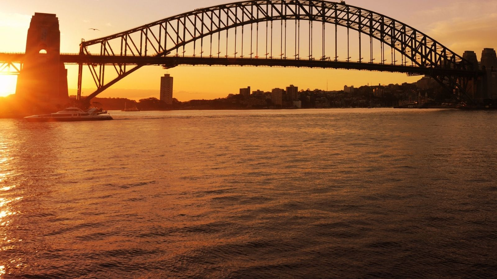 Sunset behind the iconic Sydney Harbour Bridge, Sydney, NSW, Australia